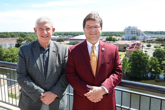 ULM President Nick Bruno (left) named Scott McDonald (right) the school's permanent athletic director after he held the interim position for nine months. McDonald, a ULM graduate and longtime supporter, was appointed interim AD in September.