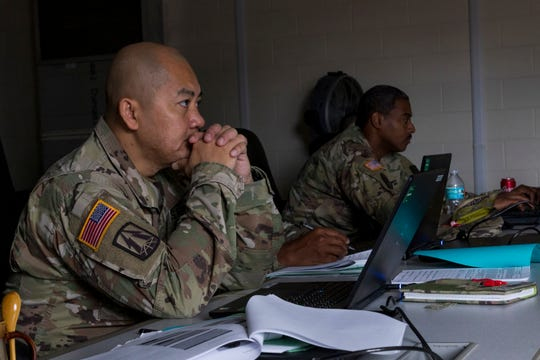 U.S. Army Reserve Lt. Col. James Bush, chief of operations,  335th Signal Command (Theater) watches a video during a Casualty Notification and Assistance Course at the headquarters in East Point, Georgia, June 11, 2019.  The Army provides training to prepare casualty notification and assistance officers for the emotional aftereffects of bearing sad tidings.