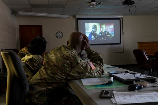 U.S. Army Reserve Soldiers with the 335th Signal Command (Theater) watch a video during a Casualty Notification and Assistance Course at the headquarters in East Point, Georgia, June 11, 2019.  The Army provides training to prepare casualty notification and assistance officers for the emotional aftereffects of bearing sad tidings.