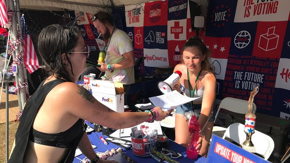 Jessi Peck of Nashville registers to vote at the HeadCountvotr booth at Bonnaroo on Sunday, June 16, 2019.