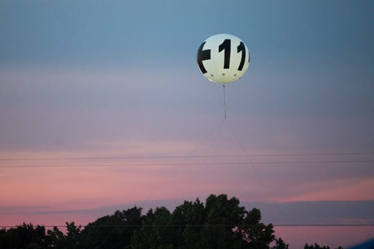 The marker for pod 11 flies in the air at Bonnaroo Music and Arts Festival in Manchester, Tenn., Saturday, June 15, 2019.