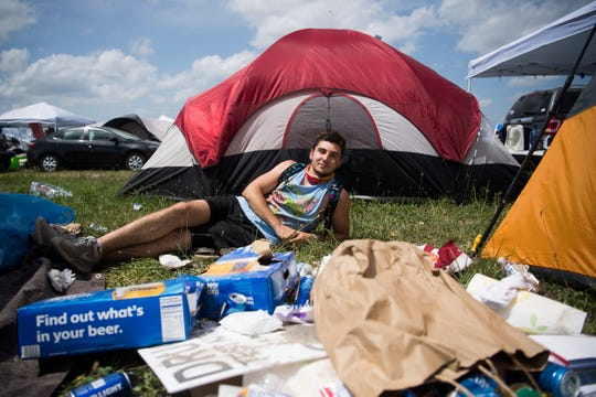 TJ Walton of Nashville poses for a photo with his campsite's trash at Bonnaroo Music and Arts Festival in Manchester, Tenn., Sunday, June 16, 2019. Walton stated his group would bag the trash before departing.