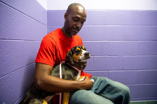 Antonio Frierson holds the two year old beagle he just adopted at Metro Animal Care and Control Sunday, June 16, 2019, in Nashville, Tenn. MACC waived adoption fees to celebrate Father's Day.