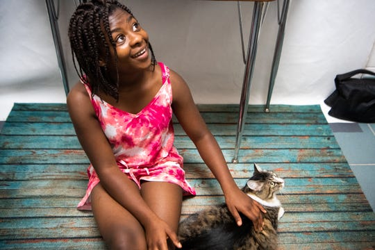 DaAisha Joyner, 13, looks to her grandma, Wanda Claybooks, as she is told they can adopt the cat, Bella, at Metro Animal Care and Control Sunday, June 16, 2019, in Nashville, Tenn. MACC waived adoption fees to celebrate Father's Day.
