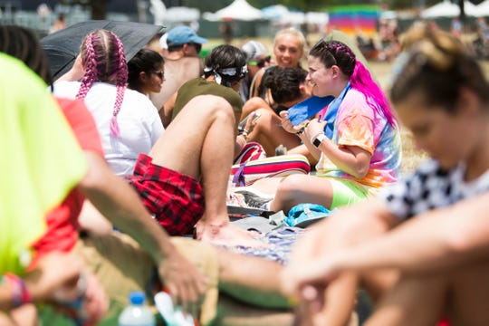 Fans sit in line at noon for a Cardi B concert which begins at 7:30 pm at Bonnaroo Music and Arts Festival in Manchester, Tenn., Sunday, June 16, 2019.