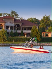 Boaters enjoy Old Hickory Lake. A home at Fairvue Plantation is on the shore.