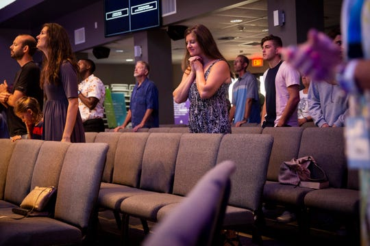 Members of the congregation participate in worship during a church service at Harvest Bible Chapel in Naples on Sunday, June 16, 2019.