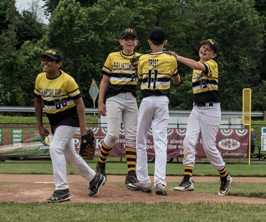 North Newark Park National Bank players celebrated at Mound City Saturday after they edged Heath Pappy's Grill 3-2 in the Varsity Division quarterfinals at the Licking County Shrine Tournament.