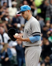 New York Yankees starting pitcher James Paxton checks a ball after Chicago White Sox's Jose Abreu hit a solo home run during the first inning of a baseball game in Chicago, Sunday, June 16, 2019. (AP Photo/Nam Y. Huh)