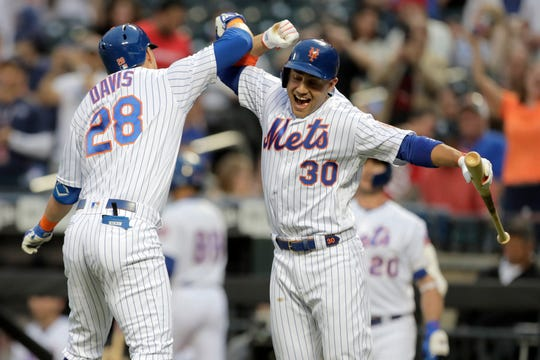 New York Mets' J.D. Davis (28) celebrates his solo home run off St. Louis Cardinals starting pitcher Michael Wacha with Michael Conforto (30) during the second inning of a game Saturday, June 15, 2019, in New York.
