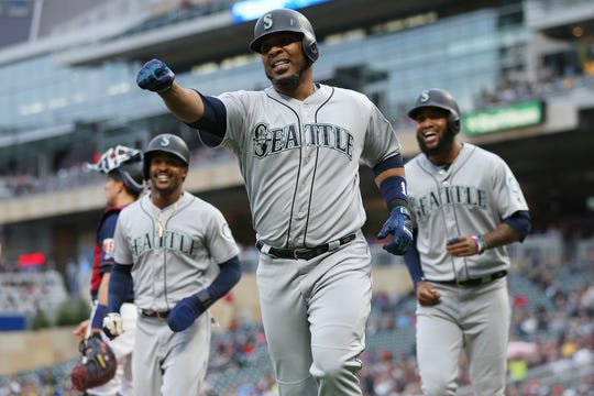 Seattle Mariners' Edwin Encarnacion runs back to the dugout in celebration after hitting a home run against the Minnesota Twins during the second inning of a baseball game Tuesday, June 11, 2019, in Minneapolis. Minnesota won 6-5.