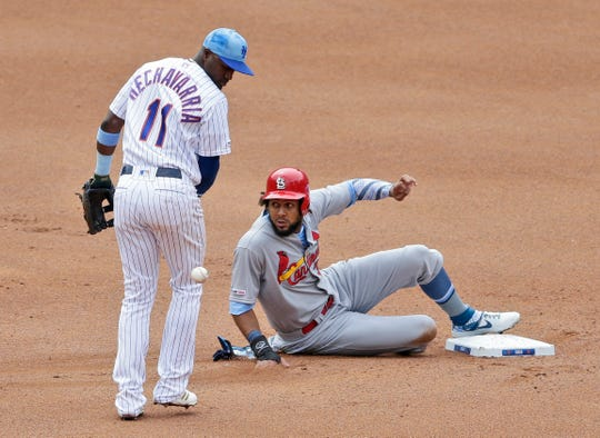 St. Louis Cardinals' Jose Martinez, right, safely reaches second base on a fielding error by New York Mets shortstop Adeiny Hechavarria, left, during the fourth inning of a baseball game at Citi Field, Sunday, June 16, 2019, in New York. (AP Photo/Seth Wenig)