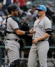 New York Yankees relief pitcher Zack Britton, right, celebrates with catcher Austin Romine after they defeated the Chicago White Sox in a baseball game in Chicago, Sunday, June 16, 2019. (AP Photo/Nam Y. Huh)