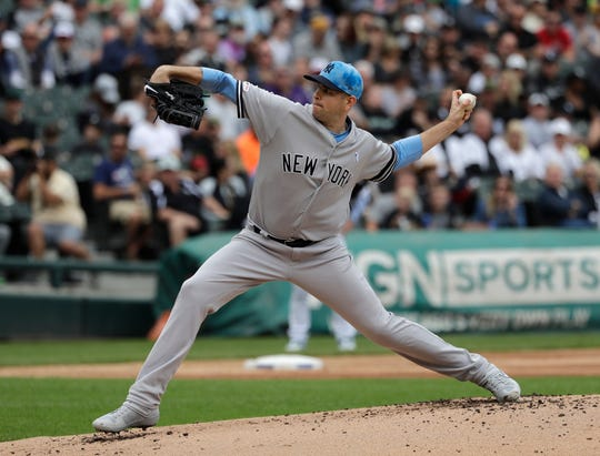 New York Yankees starting pitcher James Paxton throws against the Chicago White Sox during the first inning of a baseball game in Chicago, Sunday, June 16, 2019. (AP Photo/Nam Y. Huh)