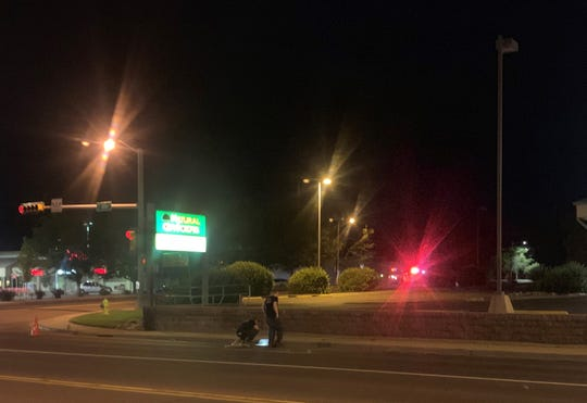 Law enforcement officers check the site of a controlled detonation of a suspicious package at 9:50 p.m. June 15 at the intersection of Butler Avenue and E. 20th Street.