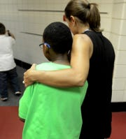 Parkview Elementary School principal Jennifer Michos gives a back-to-school hug to Jacob Grier on Sept. 8, 2015.