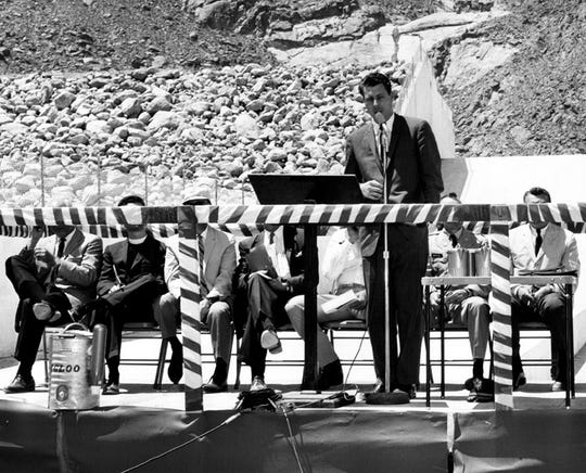 The dry falls are seen behind Democratic California Congressman John V. Tunney as he speaks during the Tachevah Dam dedication ceremony April 23, 1965.