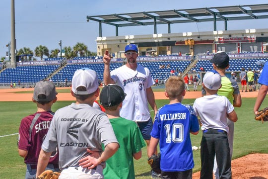 Blue Wahoos pitcher Randy Dobnak instructs youth players during Friday's Chevrolet Youth Baseball Clinic.