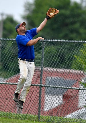 Kevin Keesey, seen here making a leaping catch earlier this season, had a grand slam in Conrads' 6-2 victory over Jacobus on Friday. He finished with five RBIs.