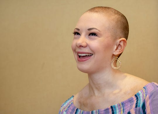 Sarah Pennington laughs during an interview. Pennington lives with Trichotillomania, a compulsive disorder defined by pulling out your own hair.  She competed in the Miss Pennsylvania Competition this past weekend.