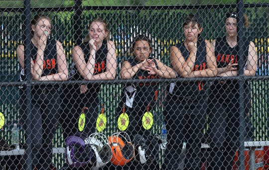 Warsaw players watch as Edison scores a run during the Class C state softball championship game at Moreau Recreational Park in Glens Falls, New York on June 15,  2019.