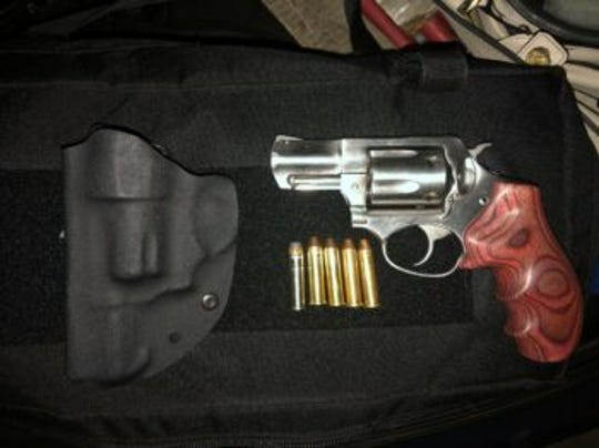 Redding police recovered an allegedley stolen handgun during a vehicle search Sunday.