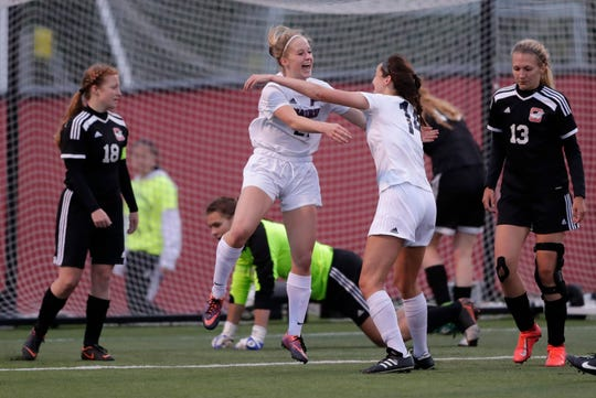 The Prairie School's Jill Decker (21) celebrates with Emma Fleming (14) after scoring a goal against Oostburg High School during their WIAA Division 4 championship girls state soccer game Saturday, June 15, 2019, at Uihlein Soccer Park in Milwaukee, Wis. Oostburg lost 2-0.
