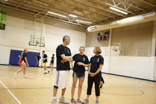Arne Duncan and family at center court at the Armijo Recreation Center.