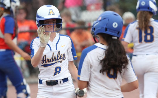 Ardsley's Sami Blackman (left) goes to high five a teammate during the Panthers' Class B state championship victory over Oneida.