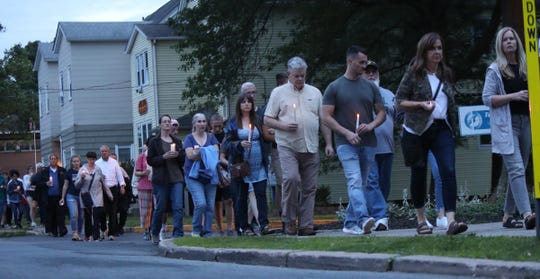 Hundreds gather for a candlelight vigil for Paula Bohovesky in Pearl River on Saturday, June 15, 2019.