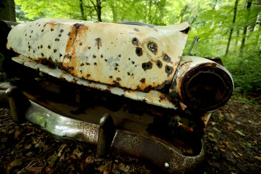 One of several long abandoned cars in Graham Hills Park in Pleasantville has what looks like bullet holes in the hood. The car, photographed June 16, 2019 is one of about six cars abandoned in the woods throughout the park.