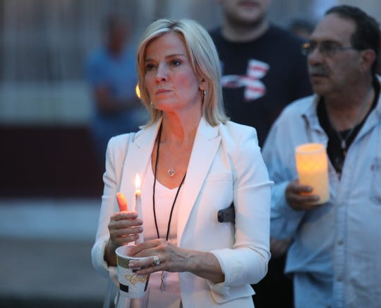 Patricia Stark walks with a candle as hundreds gather for a candlelight vigil for Paula Bohovesky in Pearl River on Saturday, June 15, 2019.