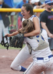 Ardsley's pitcher Gabby Krumper jumps into the arms of catcher Lauren Rende after defeating Oneida to win the state softball championship at Moreau Recreational Park in Glens Falls, New York June 15,  2019.