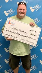 Michael Oxbrough, a 49-year-old man from Dagsboro, won $250,000 playing Money to Burn.