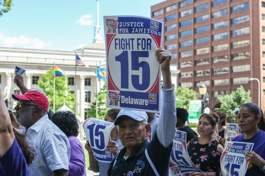 Members of the 32BJ SEIU rally at Rodney Square in Wilmington on June 14, 2019. The group called for a minimum wage increase to $15 an hour.