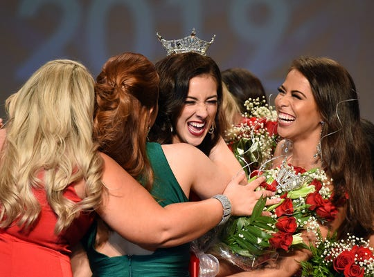 Miss Delaware contestants rush Hilary May after she was crowned Miss Delaware 2019 on Saturday, June 15, 2019.