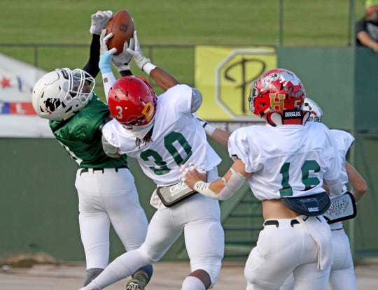 East's Jacob Williams, Burkburnett, catches a touchdown pass over West's Dante McGowan, Hirschi, (30) at the Oil Bowl Saturday, June 15, 2019, in Memorial Stadium.