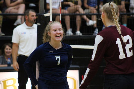 Notre Dame's Mary Grace Wallig (7) laughs with Northside's Hailey Teague in between serves.