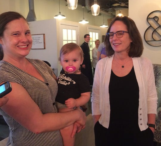 Wichita Falls ISD President Elizabeth Yeager talks with Wichitans of all ages during a watch party June 15 for the WFISD tax proposition election Saturday night at Frank & Joe's Coffee House.