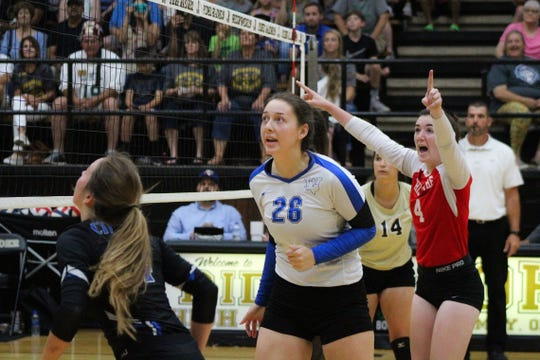 Windthorst's Mollee Kirk (26) and Chilicothe's Miranda Perkins (4) watch the ball in anticipation at the net.
