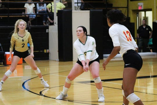 Boyd's Larrin Maxwell (3) prepares to receive the ball while teammates Danielle Okeke (13, Christ Academy) and Lindsey Dodson (2, Rider) watch.