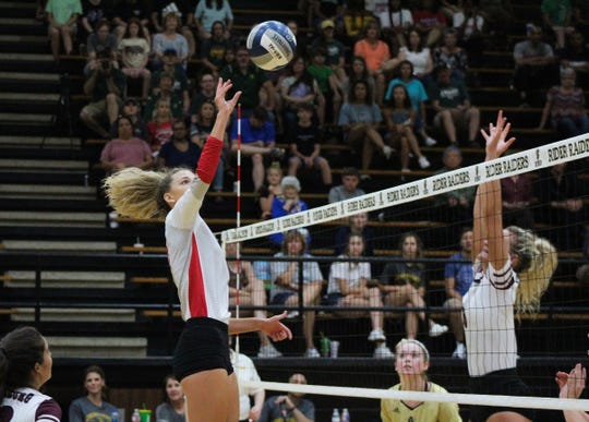 Holliday's Breanna Box tips the ball for the West team, which was victorious in two sets at the first Oil Bowl game.