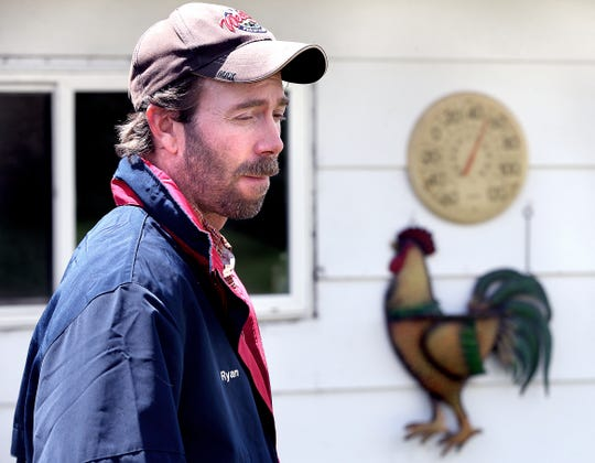 This May 20, 2019, photo shows Ryan Dunham on his farm in rural Westby, Wis. Dunham made the hard decision to sell his 50 head milking heard in April due to the challenging finances he faced from low milk prices.