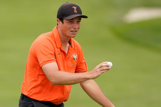 Viktor Hovland waves after his birdie putt on the sixth hole.