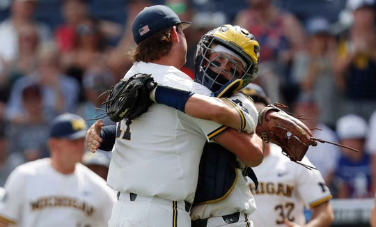 Michigan pitcher Jeff Criswell celebrates with catcher Joe Donovan after defeating Texas Tech.