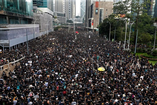Protesters pack streets against an extradition bill in Hong Kong on June 16, 2019.