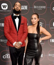 Nipsey Hussle and Lauren London arrive at the Warner Music Group Pre-Grammy Celebration on Feb. 7, 2019, in LA.