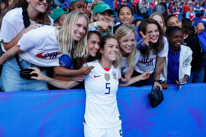June 16: U.S. defender Kelley OHara (5) celebrates with fans in the stands after the USA beat Chile 3-0 in their Group F match.