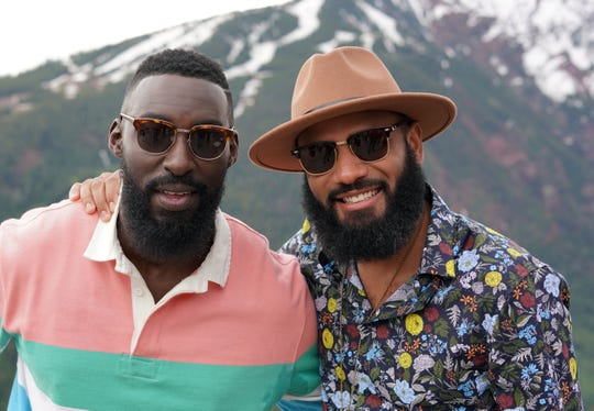 """Top Chef"" Season 16 contestants Eric Adjepong, left, and Justin Sutherland pose for a photo atop Buttermilk Mountain during the 2019 Food & Wine Classic in Aspen."