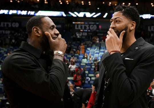 Anthony Davis and LeBron James talk during a March game.